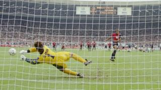 David Seaman saves a penalty from Spain player Angel Nadal.