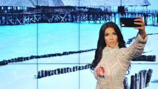 Kim Kardashian waxwork in position to take a selfie