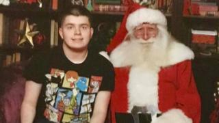 Jack Arnold sitting next to Santa