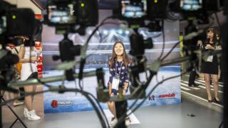 An attendant has her picture taken by a 360 degree surround ca,era system at the Mobile World Congress Shanghai in Shanghai, China, on Wednesday, June 29, 2016. (photo by Qilai Shen/In Pictures via Getty Images)