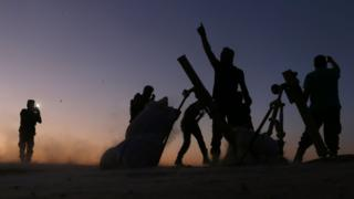 Fighters from the Free Syrian Army cheer and react as they fight against the Islamic State (IS) group jihadists on the outskirts of the northern Syrian town of Dabiq, on October 15, 2016.