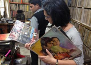 Anu looking at records
