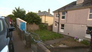 Whitecross house where man died and girl found injured