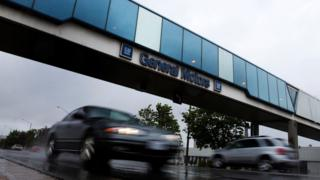 Cars pass under an overpass at the General Motors Car assembly plant in Oshawa, June 1, 2012.