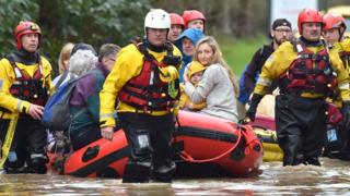 A rescue boat takes residents to safety in Nantgarw, near Cardiff