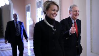 Senate Majority Leader Mitch McConnell (R-KY) gives a thumbs-up as he and his Director of Operations Stephanie Muchow head for the Senate floor at the U.S. Capitol December 1, 2017 in Washington, DC