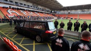 Funeral cortege passing through Bloomfield Road