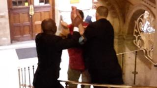 Mike Rowley being restrained