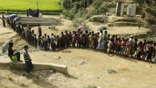 Rohingya refugees queue at a camp in Bangladesh