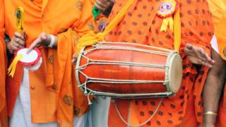 Sikhs playing music instruments