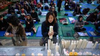 Parents pray for their children's success at a temple in Seoul