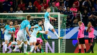 Slovenia's Roman Bezjak (jumping) celebrates