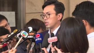 Avery Ng Man-yuen speaking outside West Kowloon Law Courts