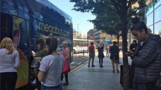 Passengers waiting for Megabus