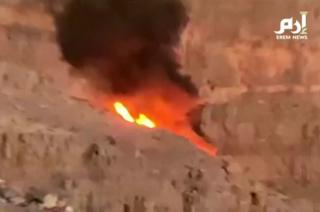 A still image taken from video footage shows a ball of flame where the helicopter crashed