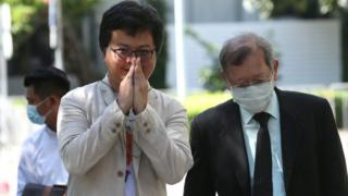 Thai lawyer and pro-democracy activist Anon Nampa (L) arrives at the Criminal Court in Bangkok, Thailand