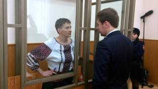 Ukrainian army pilot Nadia Savchenko talks to her lawyer Ilya Novikov from glass-walled cage in court hearing in town of Donetsk in Rostov region, Russia, March 3, 2016
