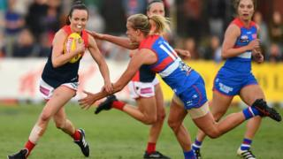 AFL Women's player Daisy Pearce, for the Melbourne Demons, breaks away from an opponent