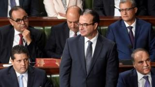"""Slim Chaker attends a parliamentary session ahead of a vote of confidence in the prime minister""""s reshuffled government, on September 11, 2017, in Tunis."""