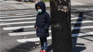 Child wearing face mask in Brooklyn, New York - 2 April