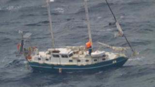 The couple's yacht in heavy seas off the coast of Sydney, Australia.