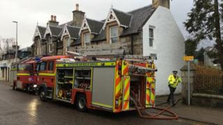Firefighters and police at scene of fire in Grantown on Spey