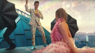 Brandon Urie in Me! video shown on rooftop with Taylor Swift