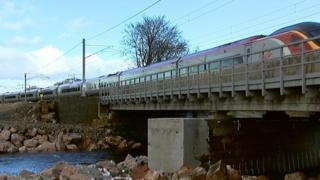 Train going over mended viaduct