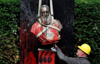 in_pictures A man removes a vandalised statue of King Leopold II of Belgium
