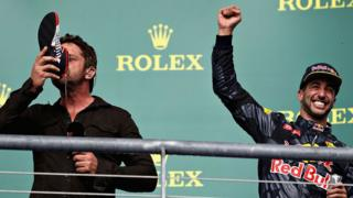 Gerard Butler does a 'shoey' with Daniel Ricciardo at the US Grand Prix