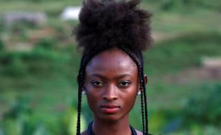 Sandra Kouadio poses with her hairstyle in Abidjan, Ivory Coast, October 13, 2017.