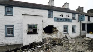 Hole in the Black Lion pub