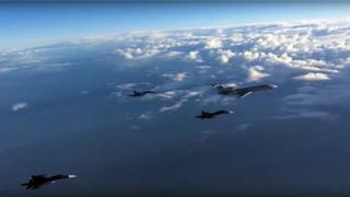 Russian footage of planes leaving Syria