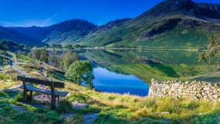 Wooden bench overlooking Buttermere in the Lake District
