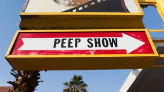 Showgirl's 'Peep Show' sign with arrow