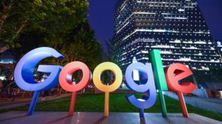 The Google Inc. logo is illuminated in front of Google Beijing Office