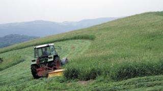 Tractor on grassy slope