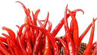 Chillies arranged like flames in a fire