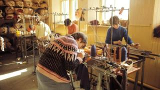 Various women operate knitting machines making Fair Isle knitwear on one of the Shetland Islands in 1970.