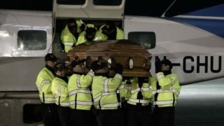 The bodies of nine Costa Ricans are received by authorities at Juan Santamaria Airport in San Jose, Costa Rica, 24 January 2016