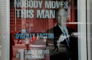 A poster for O'Reilly's show hangs outside the Fox News offices in New York City