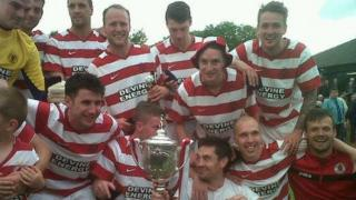 Shaun Woodburn (top right) celebrating East of Scotland cup victory with Bonnyrigg Rose