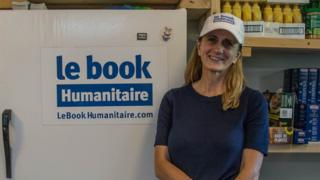Portrait of Rachel Lapierre in Le Book Humanitaire's office. Behind her, a fridge and food that she keeps for people in need.
