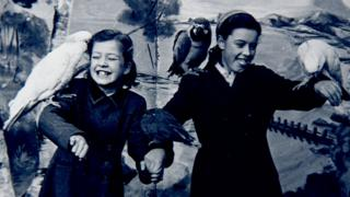 Mary and Eileen holding parrots