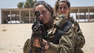 Female Israeli soldiers practise shooting on 6 July 2016 in Nitzana, Israel
