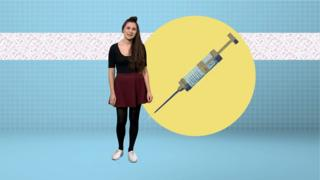 Woman standing next to image of a big syringe