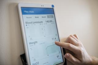 An app which monitors vital signs such as blood pressure