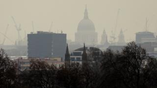 Pollution over London city skyline showing St Paul's Cathedral, seen from Primrose Hill