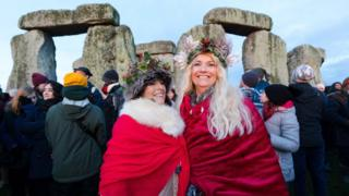 Revellers take part in the winter solstice celebrations at the ancient Stonehenge monument in Wiltshire, Britain, 22 December 2019.