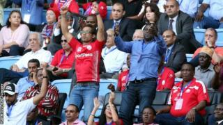 Simba's part owner Mohammed Dewji celebrates with fans at a game